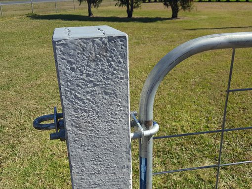 How to attach a gate to concrete strainer post